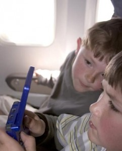 Young boy playing video game on airplane