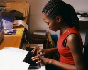 Teenage Girl Typing on Computer Keyboard